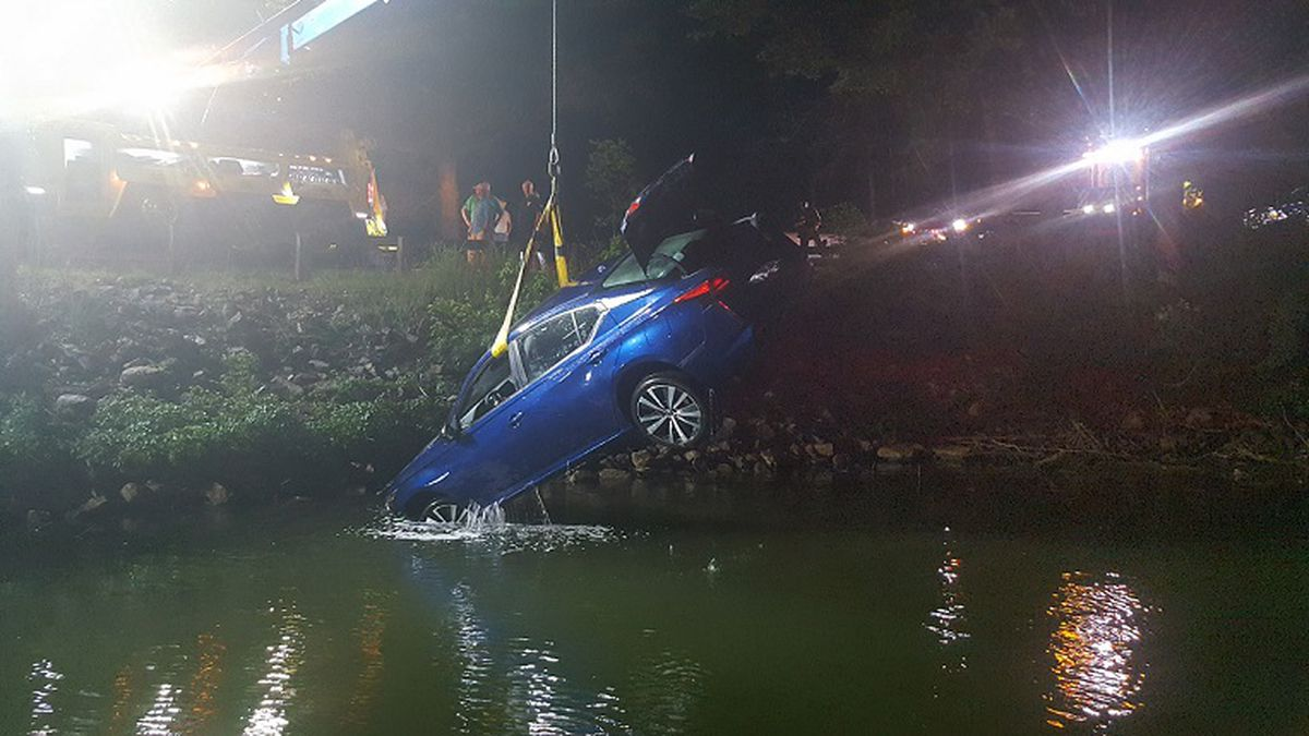 A car is pulled from Smith Mountain Lake after a crash.