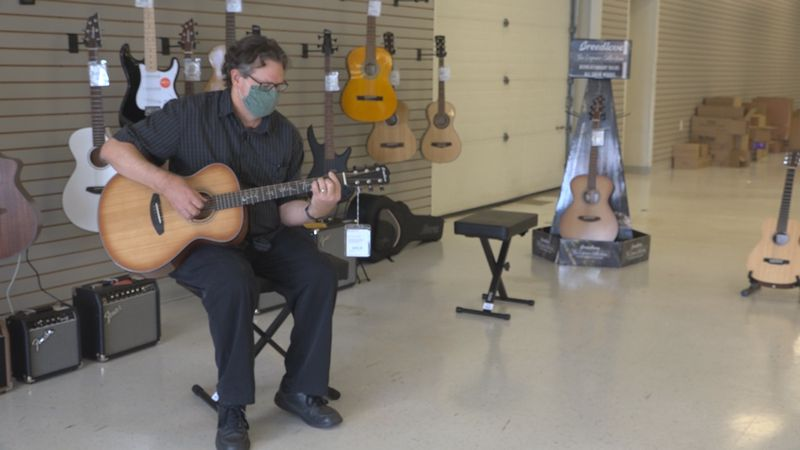 Marks said he had about 100 guitars in his old store and is now left with only a few dozen.