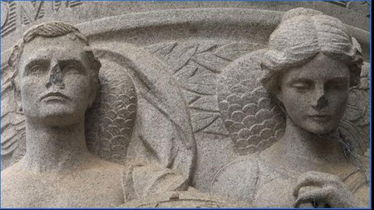 Image of angelic figures at the base of Charlottesville's Stonewall Jackson statue with noses...