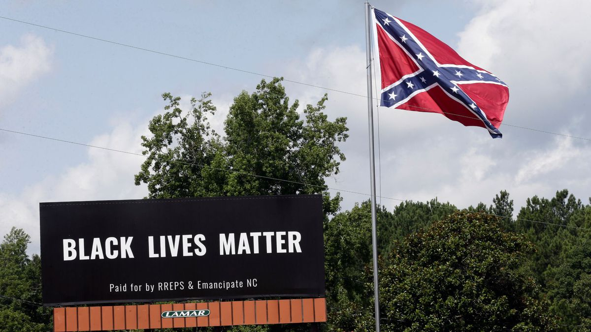 Black Lives Matter billboard placed next to Confederate flag