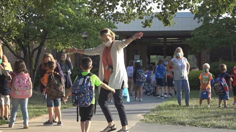 Teachers stood outside Sandy Hook Elementary School as they welcomed close to 900 students back...