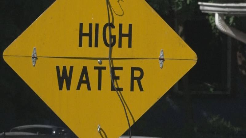 High water sign off of Madison Street.