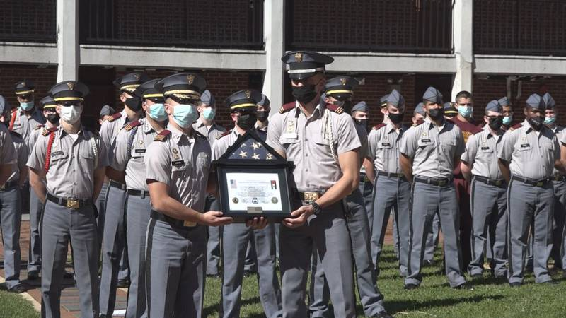 Fishburne Military School Battalion Commander Jarvis accepts the dedicated flag and certificate...