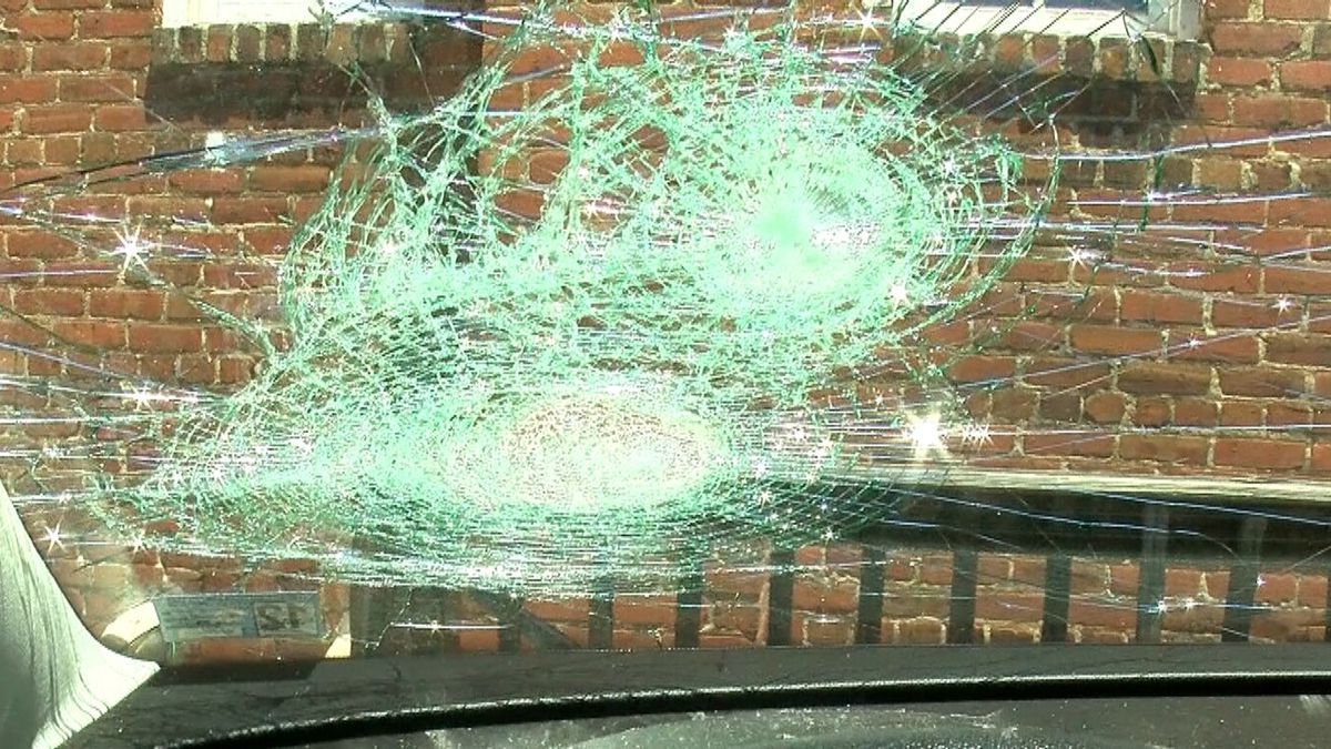 A Henrico woman says a violent group of protesters threatened her while driving down the street and damaged her car.