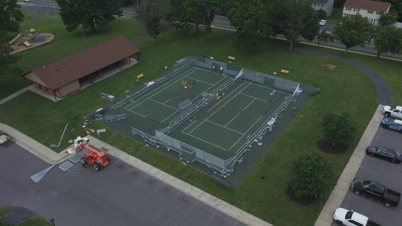 The two courts will replace existing tennis courts at the park.