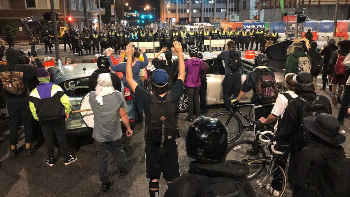 Tensions between police and protesters flared again, as Richmond police declare an unlawful assembly for the second consecutive night - this time in front of city hall. (Source: NBC12/Eric Everington)