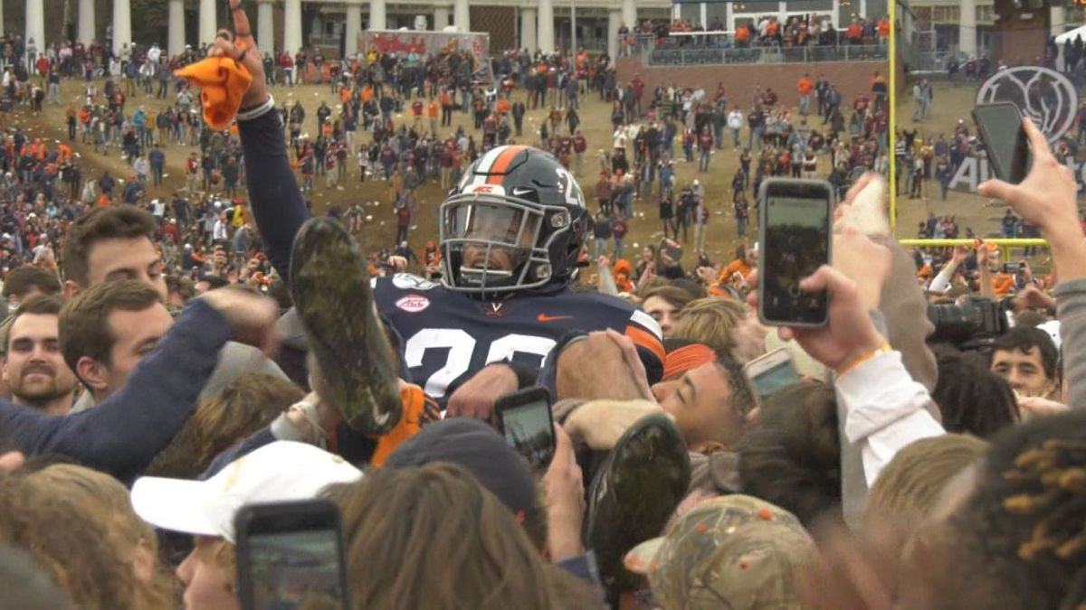 Virginia beats Virginia Tech 39-30 and fans storm the field, celebrating end of 15-year drought.