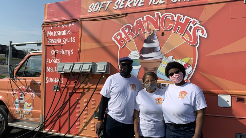 The Branch Family stands in front of their soft serve truck.