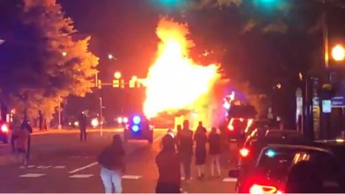 As the night turned violent, protesters set fire to a Pulse bus, leaving it destroyed. (Source: NBC12)