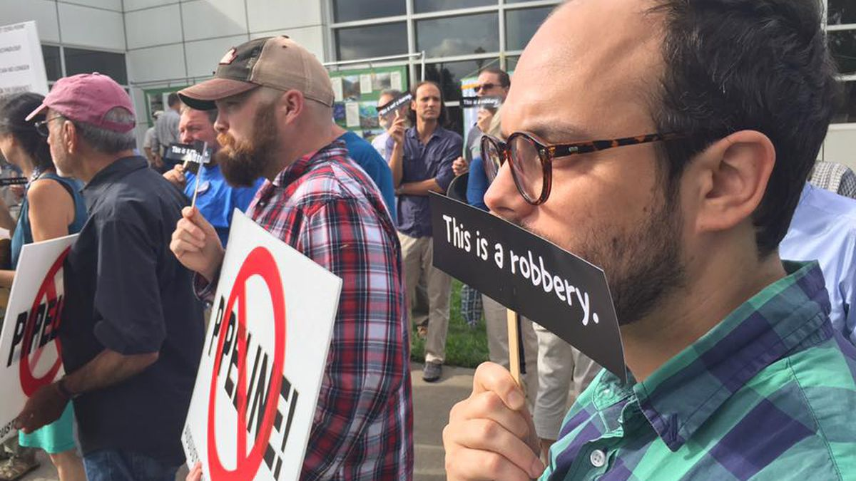 Protesters at a Virginia Department of Environmental Quality public meeting to discuss water...