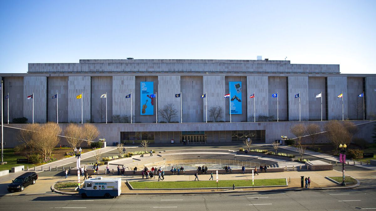FILE - In this April 3, 2019, file photo people visit the Smithsonian Museum of American...