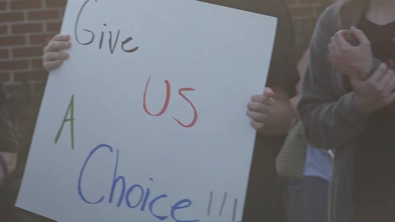 Community members outside of the Shenandoah County school board meeting 8/12/21