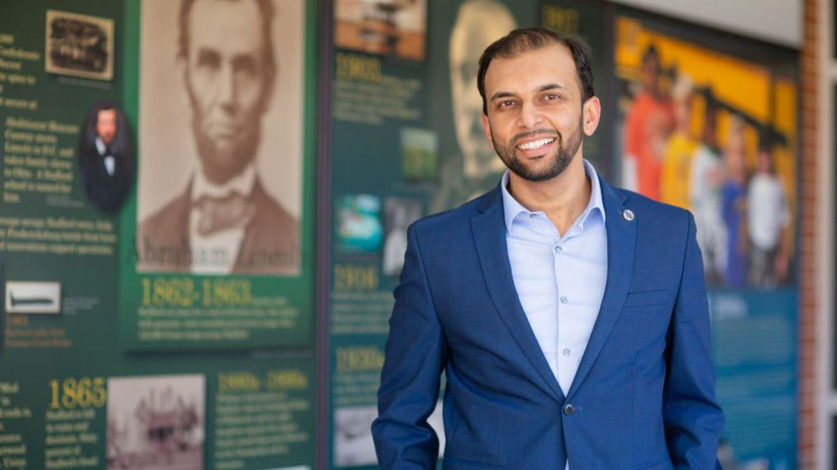 FILE - In this March 23, 2019 file image provided by the campaign of Qasim Rashid, state Senate candidate Qasim Rashid poses at the Stafford County Courthouse in Stafford, Va. A federal judge refused Monday, Sept. 16, 2019 to throw out a case in which a North Carolina man is charged with anonymously threatening to lynch Qasim Rashid, a Muslim-American man who is campaigning for a state Senate seat in Virginia. (Marion Meakem Photography/Quasim Rashid Campaign via AP, File)