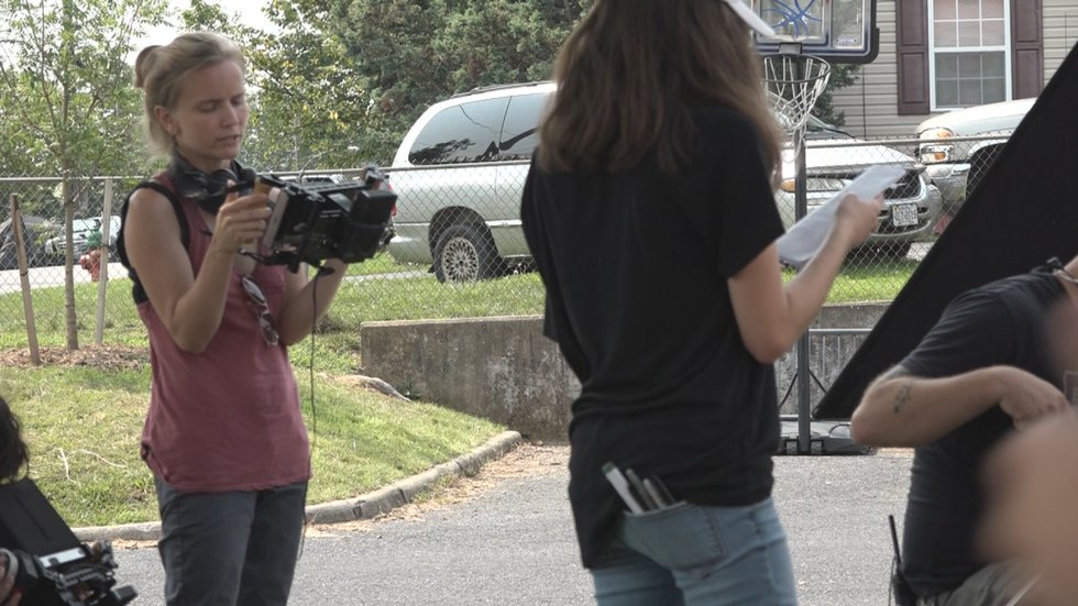 Lysandra Petersson directs her movie, 500 Fireflies on Nelson St. in Staunton, VA, on Tuesday,...