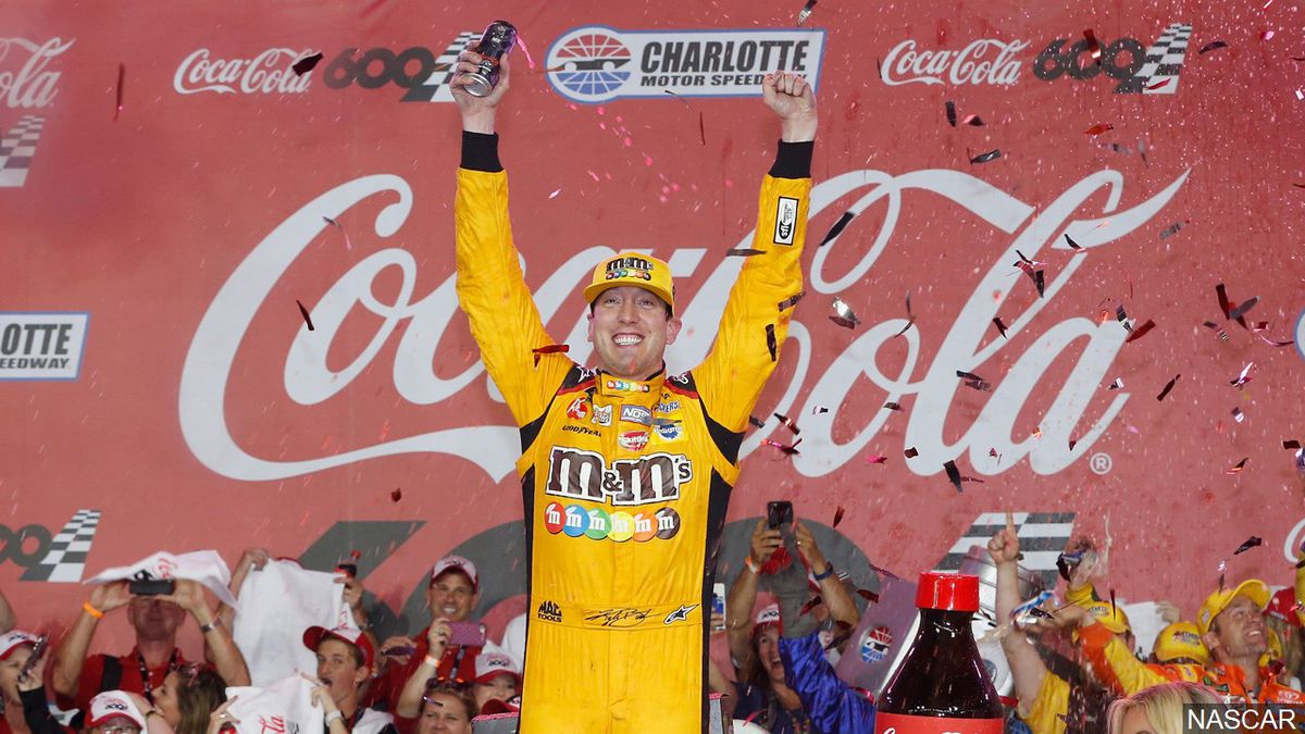 Kyle Busch, driver of the #18 M&M's Toyota, celebrates in victory lane after winning the Monster Energy NASCAR Cup Series Coca-Cola 600 at Charlotte Motor Speedway on May 27, 2018 in Charlotte, North Carolina