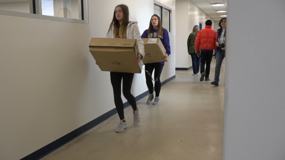 Eastern Mennonite School students helping move supplies into new building for K-5. | Credit: WHSV