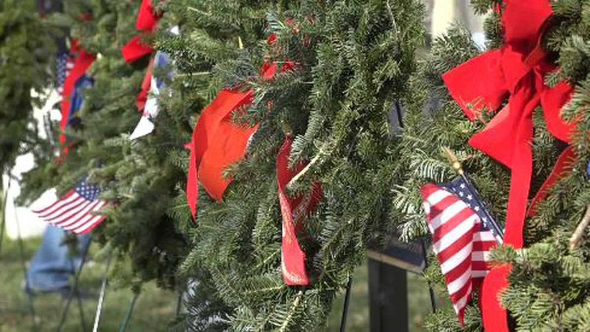 Wreaths were also put in place in the center of the cemetery to represent each branch of the...