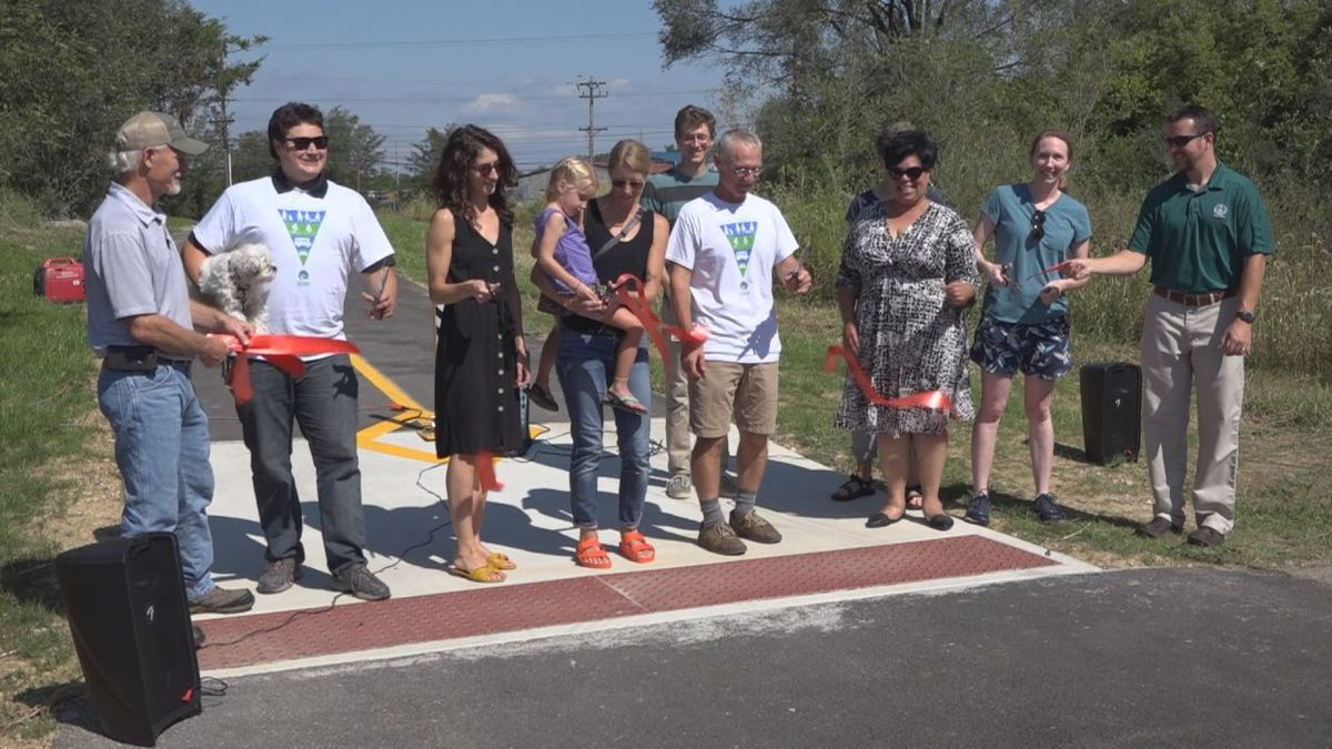 Community members and city leaders cut the ribbon to signify the opening of the Northend Greenway | Photo: WHSV