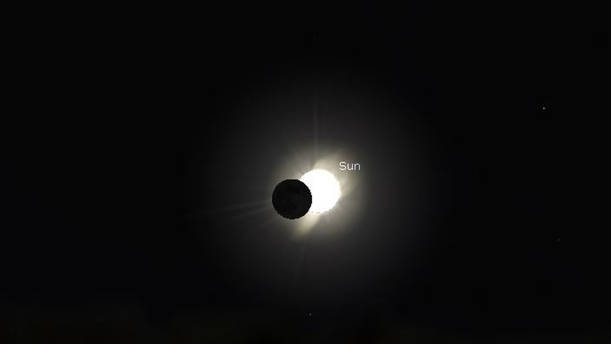 Partial solar eclipse as the sun rises Thursday morning. Peak cover of the sun will be around...