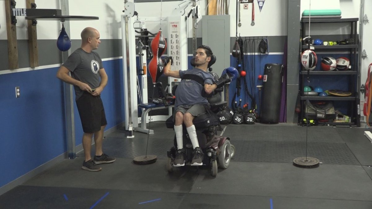 Daniel Barnhart, one of the scholarship recipients, practices boxing with his trainer, Randy...