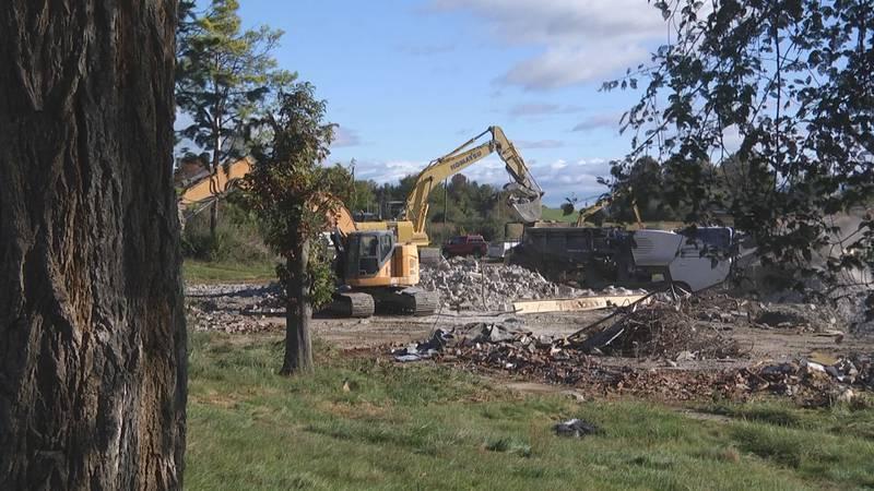 Crews working to demolish 19 buildings in the Staunton Crossing development project.