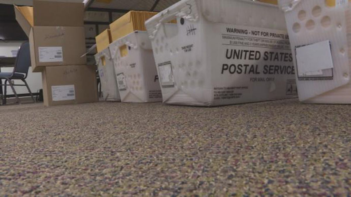 Baskets of absentee ballots in a county clerk's office about to be sent to West Virginians