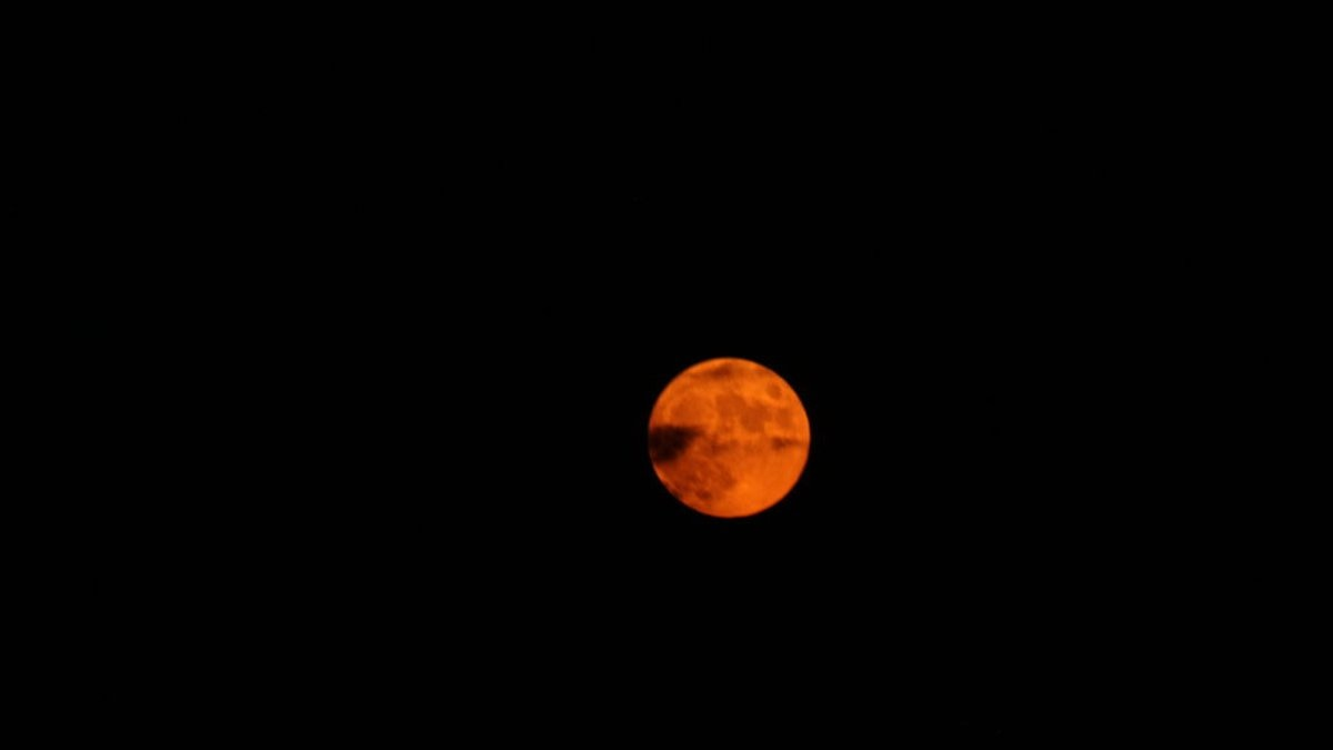 July's Full Moon was on Friday night and created an interesting color thanks to haze in the air.