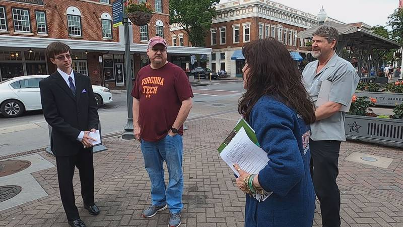 Candidates for the Constitution Party of Virginia collected signatures in Roanoke  to qualify...