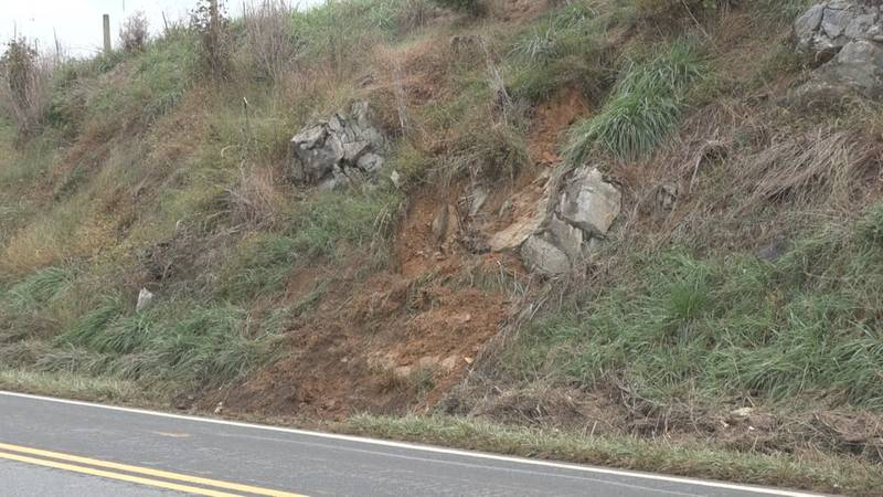 Heavy rain caused a portion of this cliff to slide onto the roadway.