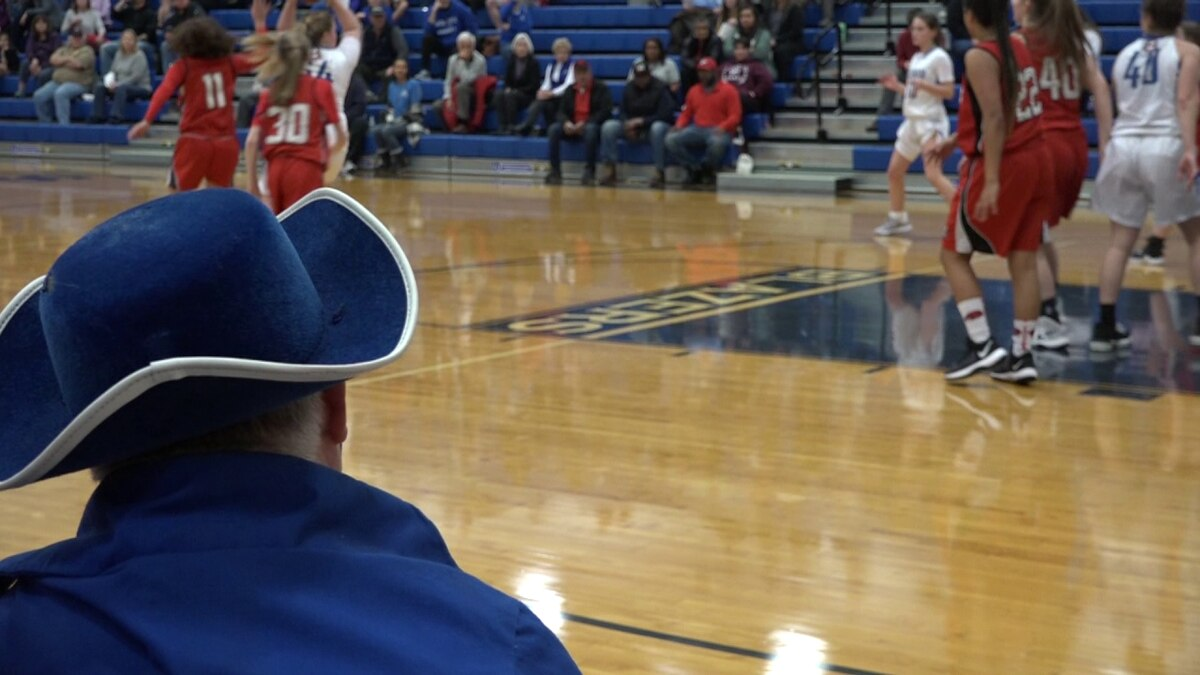 Matthew sits on the sidelines as he cheers on the Spotswood Girls Basketball team.