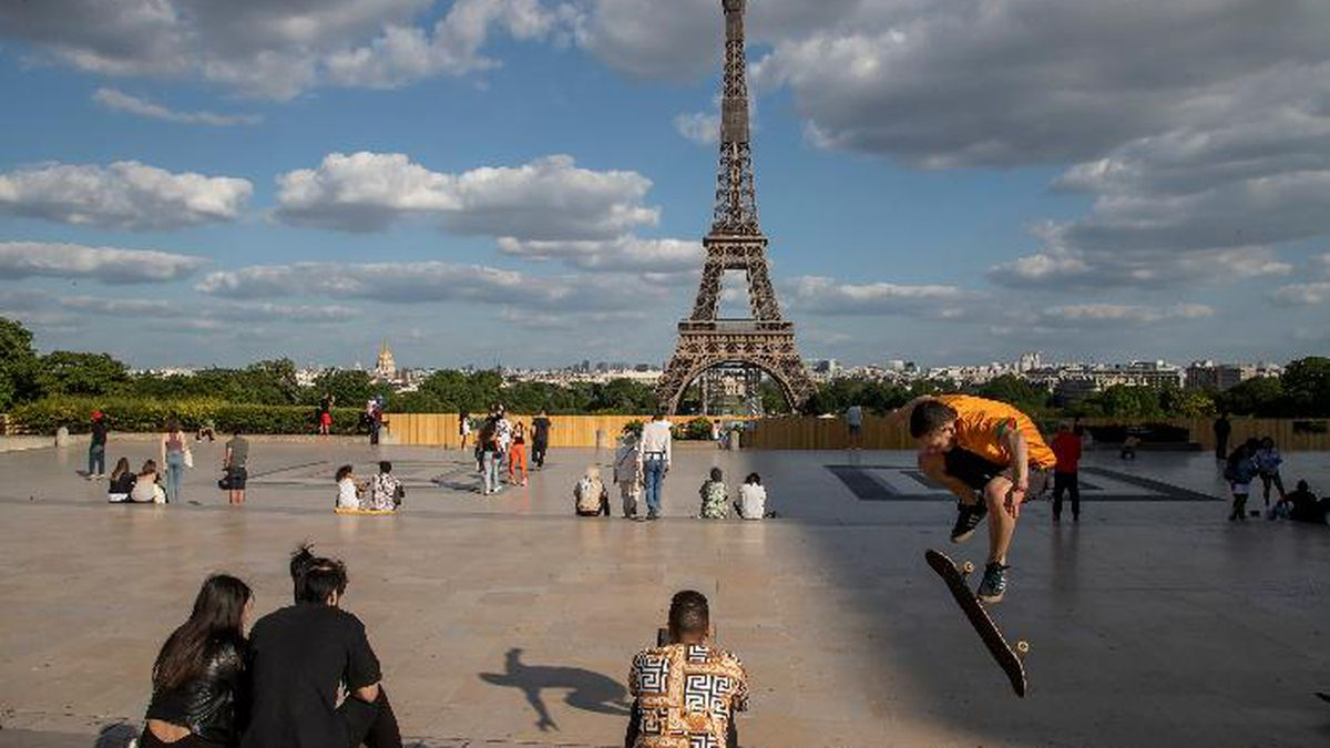 People stroll at Trocadero square near the Eiffel Tower in Paris, Monday, May 25, 2020, as...
