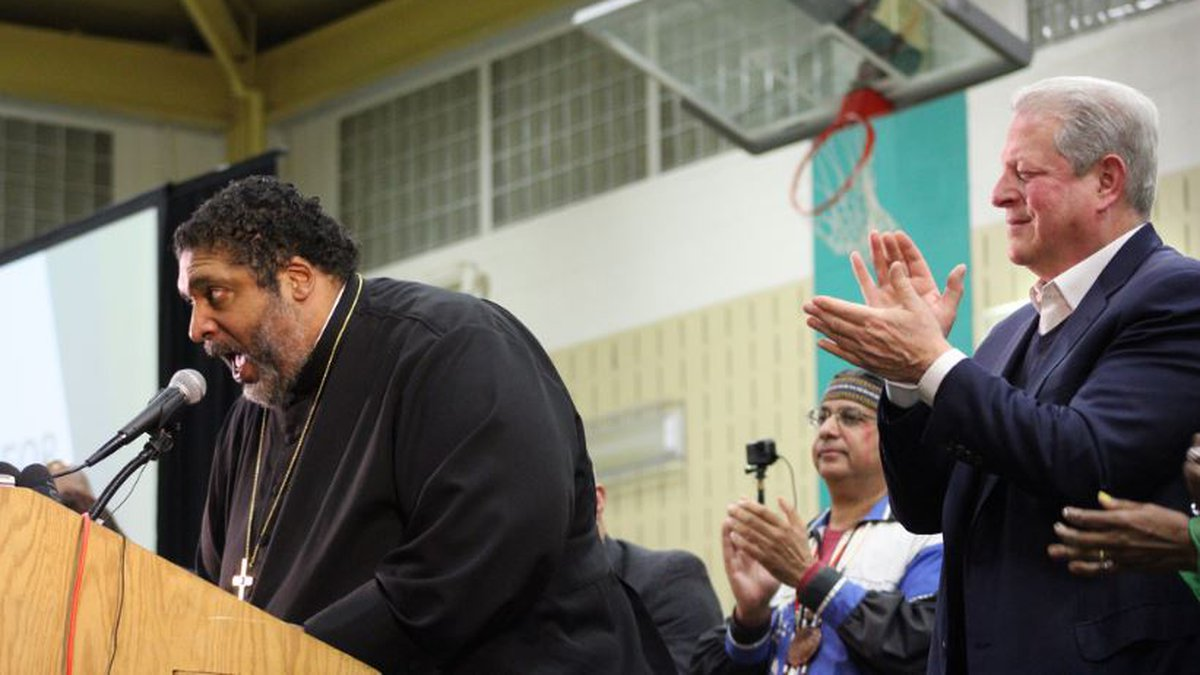 The Rev. Dr. William Barber II delivers passionate speech, drawing applause from former Vice...