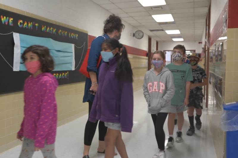 Students at Honey Run Elementary School walking in the hallway back on Oct. of 2020.