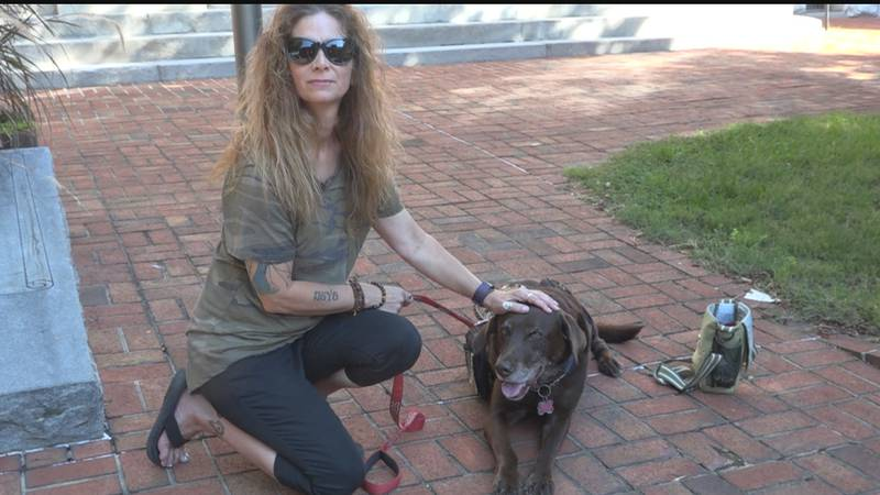 Helyn Stowe and her service dog Astro
