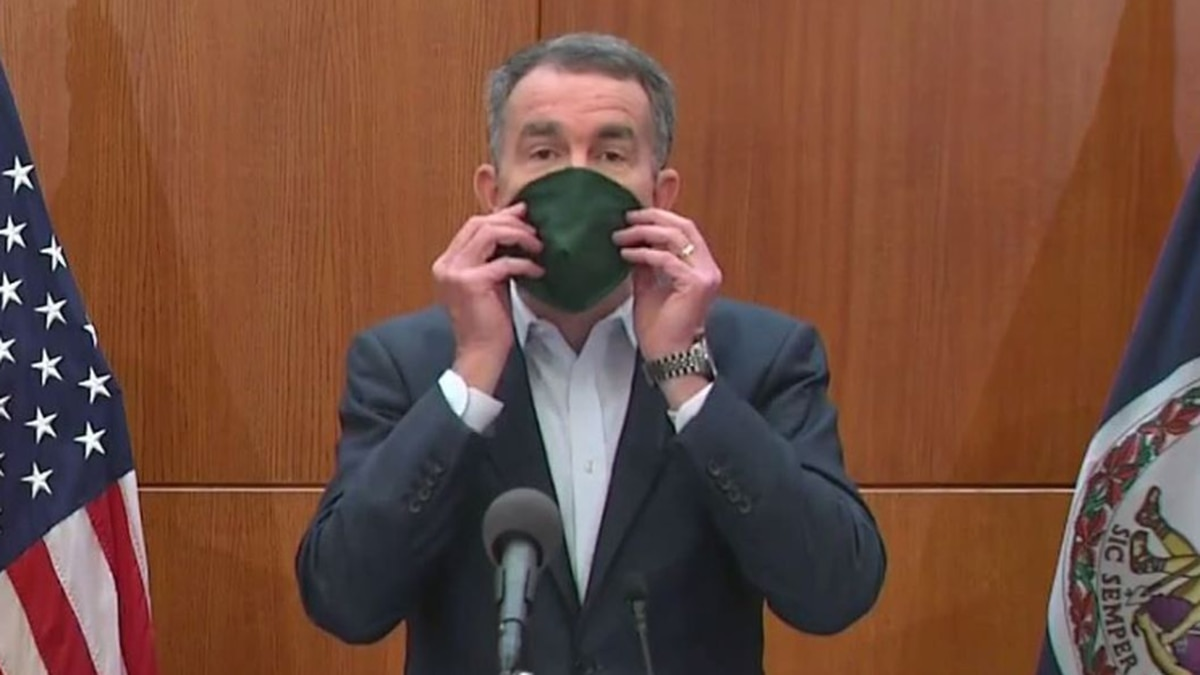 Governor Ralph Northam demonstrated how to use a mask on April 6 with his own, which was among...
