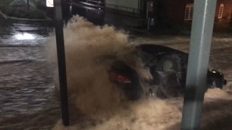 Water rushing down Central Avenue