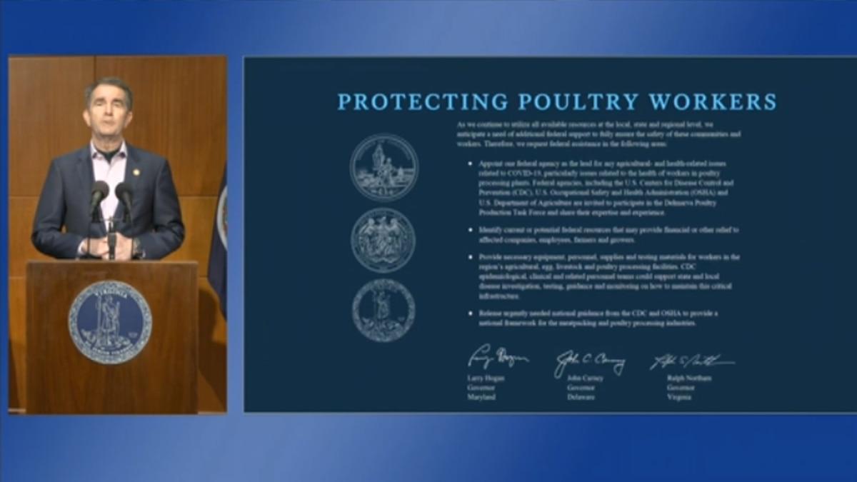 Gov. Ralph Northam alongside a slide during his April 27 press briefing on Virginia's response to the coronavirus.