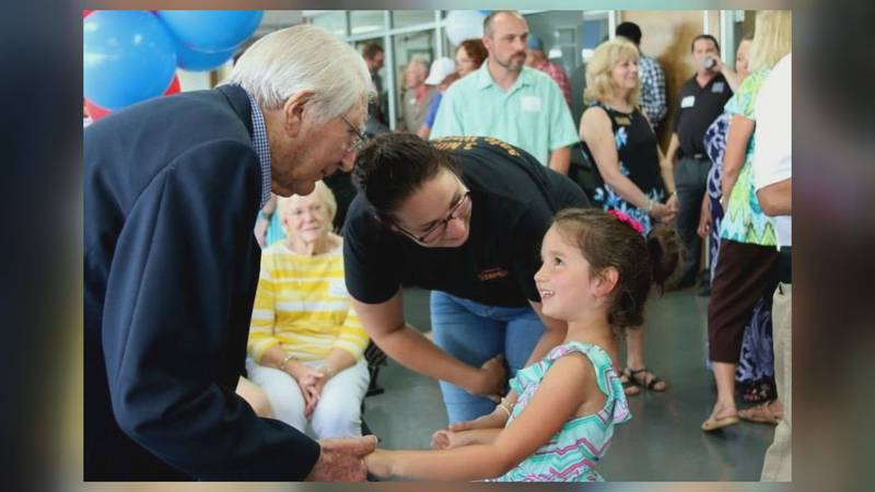 Paul Obaugh greets guests at Paul Obaugh Ford. (WHSV)