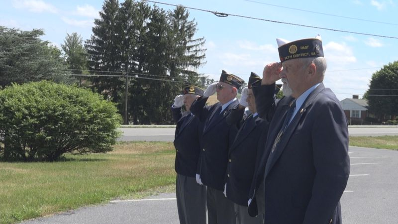 """Veterans with the Dayton American Legion salute during """"Taps."""""""