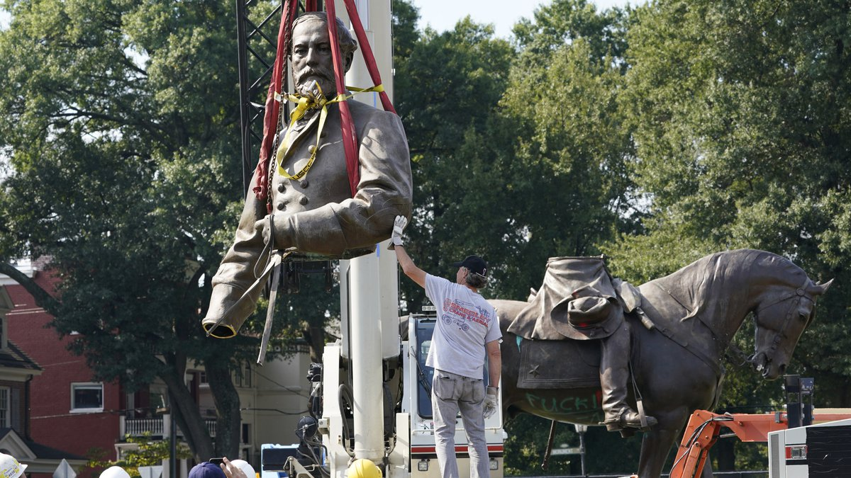 Richmond's massive Robert E. Lee statue removed from pedestal, cut into pieces