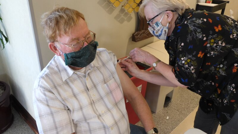 A vaccine is administered at a Valley Health COVID-19 vaccine clinic.