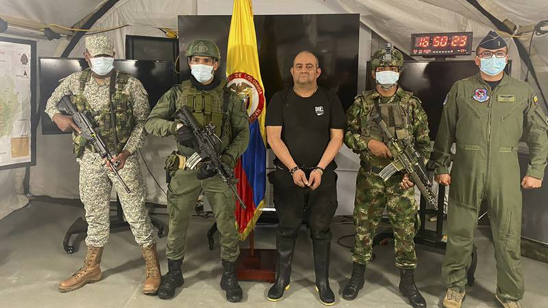 In this photo released by the Colombian presidential press office, the country's most wanted...
