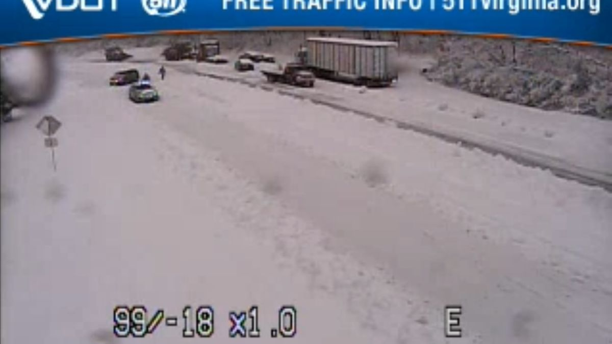 View from the VDOT traffic camera at Swift Run Gap as of 2:34 p.m. on March 21, showing several vehicles stuck in around 4 inches of snow as crews work to clear the highway.