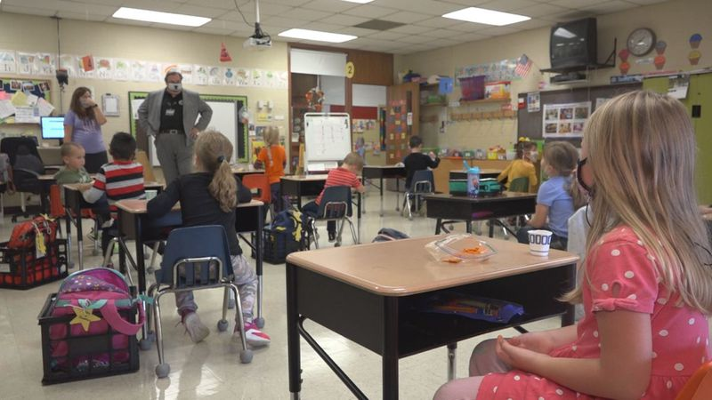 Kindergarten students taking a snack time break during class.