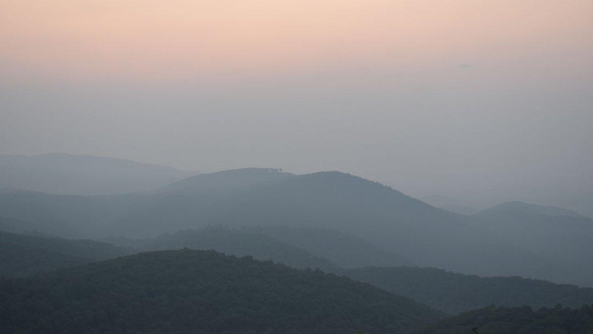 Wildfire smoke kept a smoky haze over the region.