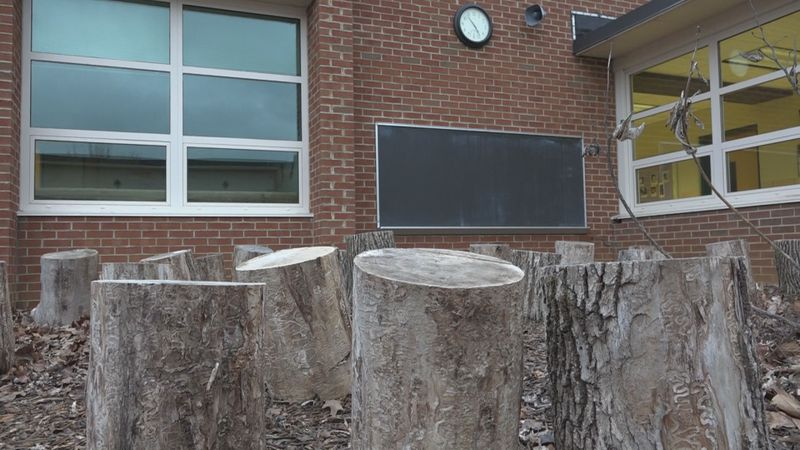 Old blackboards from classrooms have been installed outside the school building to be used for...