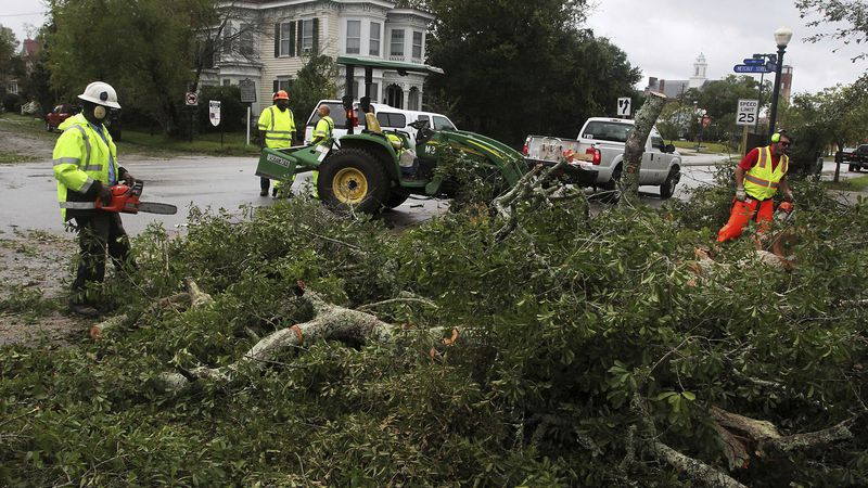 City of New Bern crews work to clear storm damaged trees in historic New Bern, N.C., Sept. 15,...