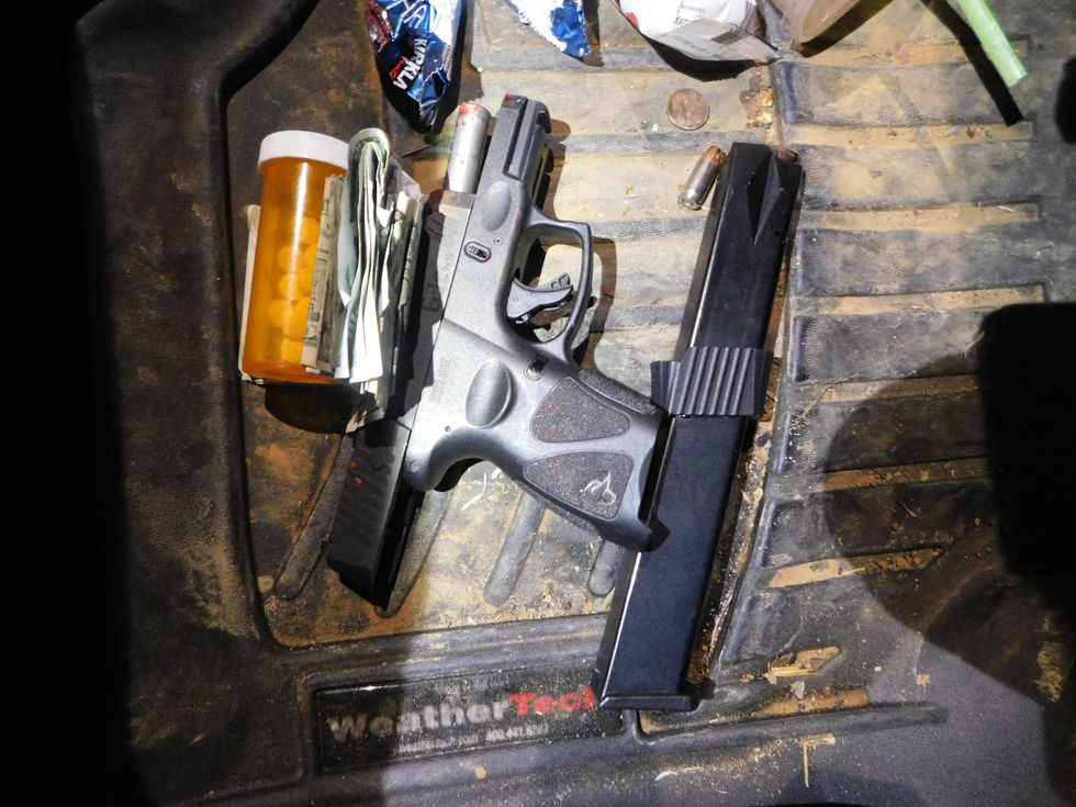A gun found by officials in Gregory's vehicle.