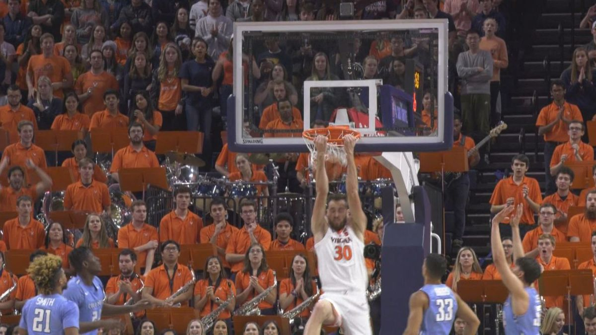 Jay Huff throws down reverse slam during a Virginia win over Columbia.