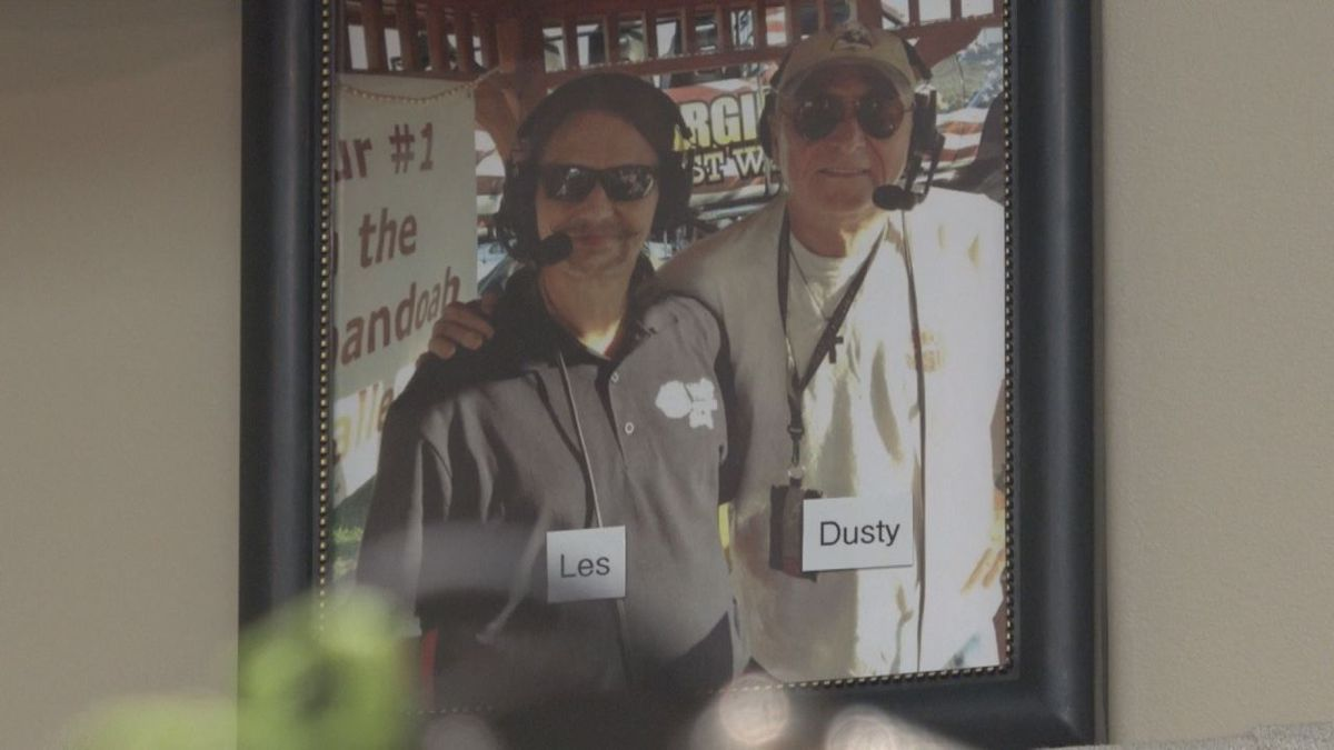 This photo of Dusty standing with Les -Bluegrass another DJ at WSIG hangs in the stations studio.